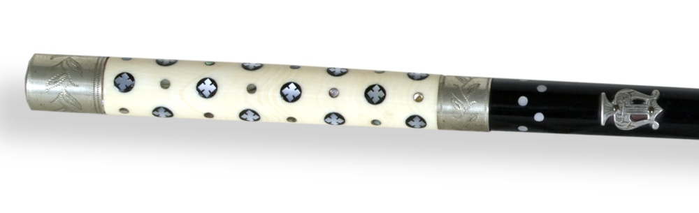 Close-up of Pence Band baton