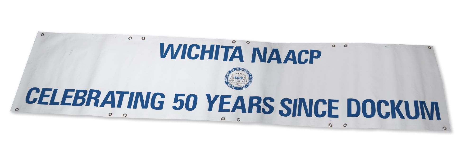 Banner from march commemorating a sit-in at the Dockum Drug Store in Wichita