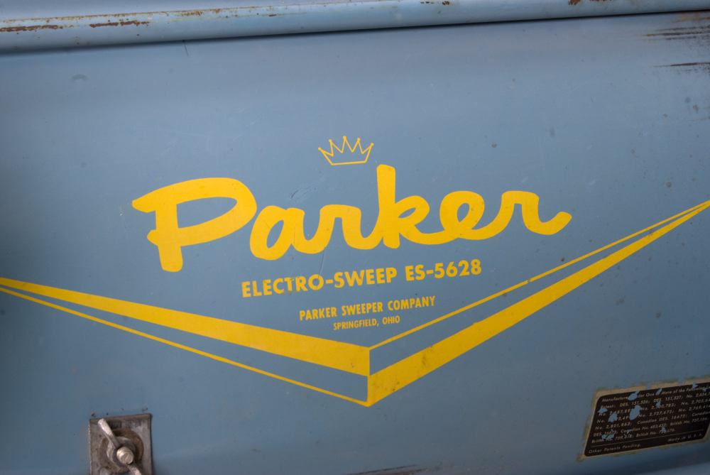 Close-up of Parker logo on lawn sweeper