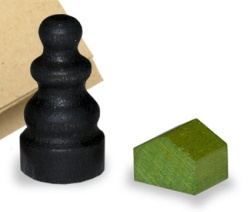 Close-up of wooden Monopoly game pieces