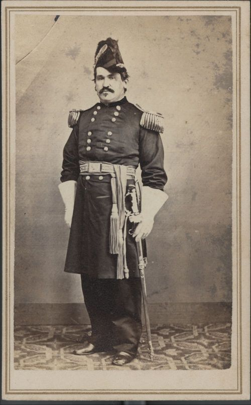 Blunt with his presentation sword, epaulets, and sash