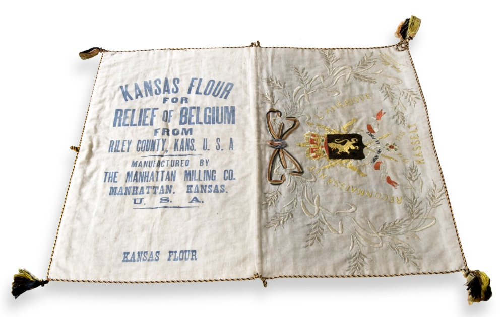 Embroidered flour sack originally sent by Riley County.