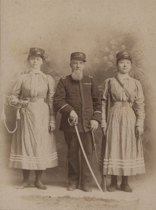 Horatio Boyd with two of his Girl Cadets