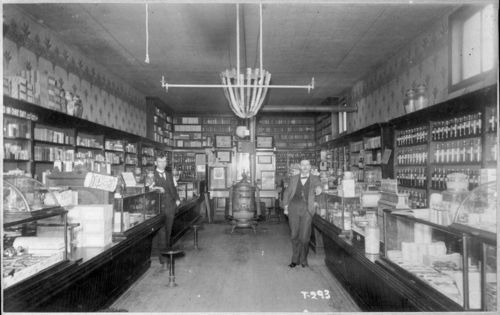 "Topeka drug store with ""Pink Pills"" sign on lefthand counter, ca. 1900"