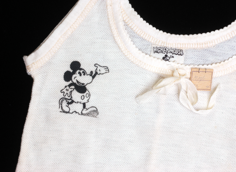 Close-up of Mickey Mouse logo at neckline