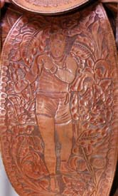 Saddle fender tooled with depiction of Willard as boxer