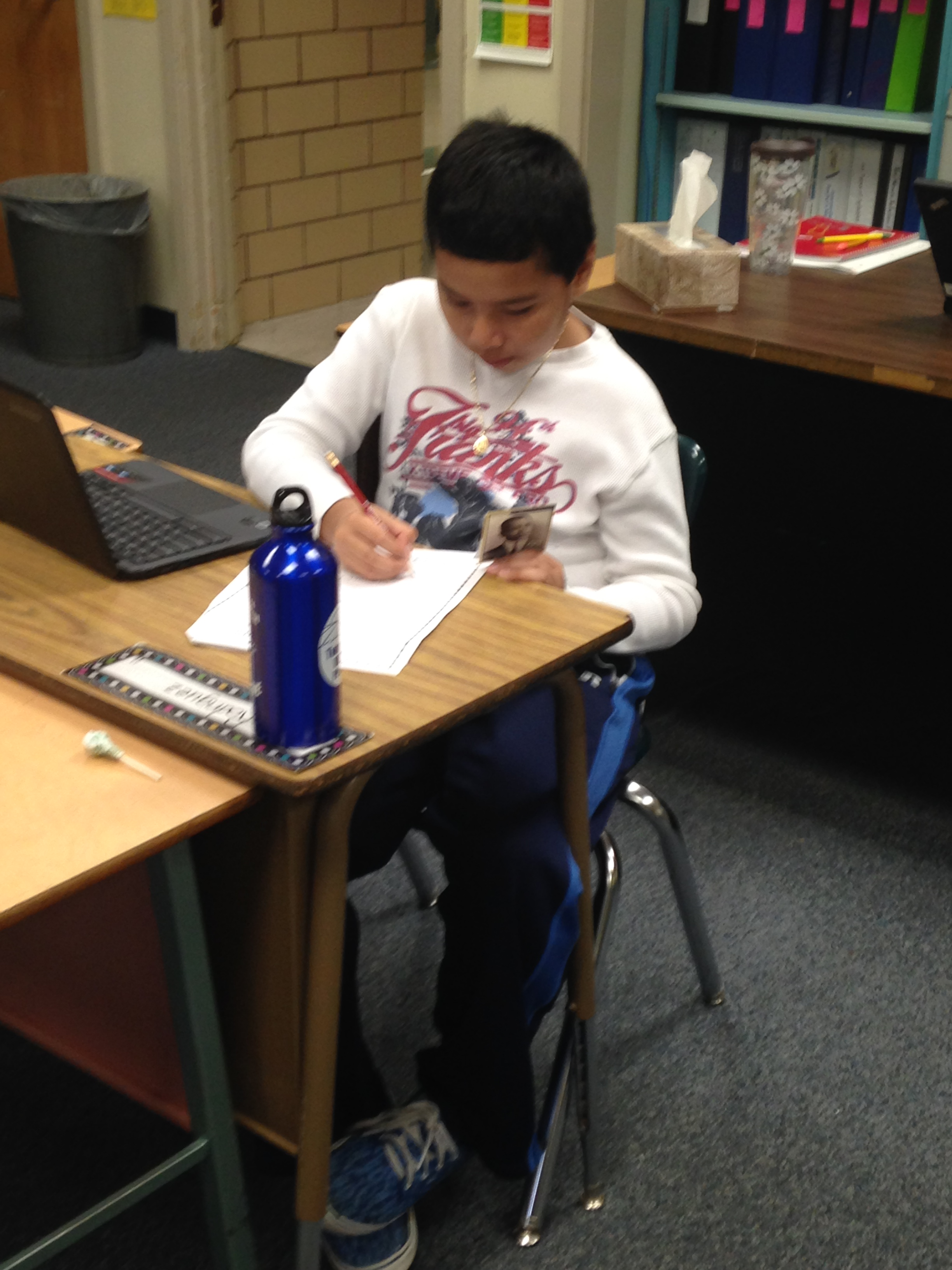 Fourth grader working on his Famous Kansan project