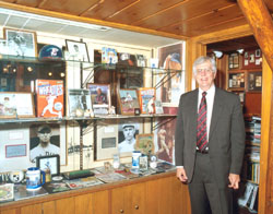 Norman and his collection of baseball memorabilia.