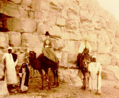 Perkins and his wife are pictured riding camels at the Egyptian pyramids at Cheops in 1900
