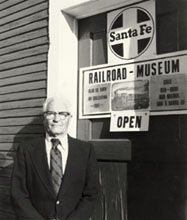 Bud Goebel standing outside his railroad museum.