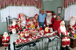 Bruce and Lee with a portion of their Santa Claus collections.