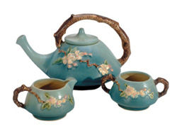 Apple Blossom tea set made by Roseville Pottery Company.