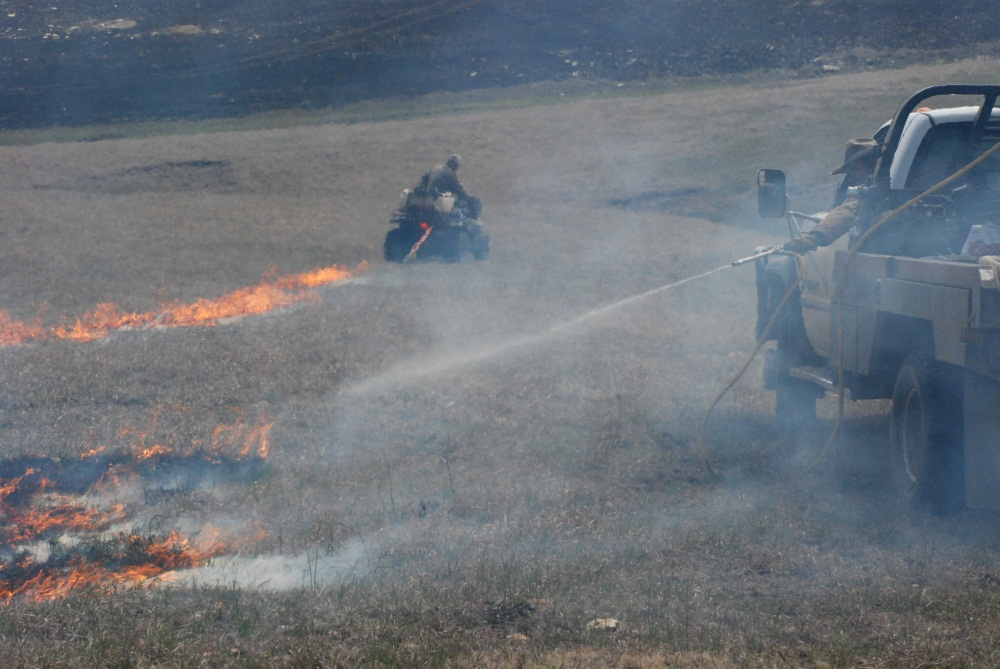 The Talkington family conducts a controlled burn on their Flint Hills ranch, 2007.