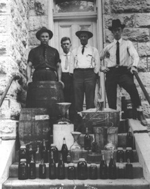Officials with confiscated bootlegging materials on the steps of the Greenwood County Courthouse, 1923.