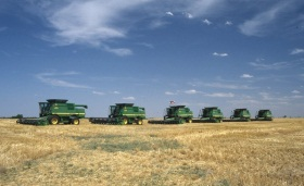 Combines lined up in a Harper County field, 1998.