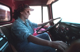 Lee Cox driving a wheat truck, Anthony, 1998