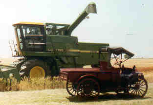 1911 International truck in front of 1984 combine.