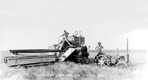 Harvest on the Stude farm near Copeland, 1928. John Stude stands on the tractor; Horace Roe is on the combine.