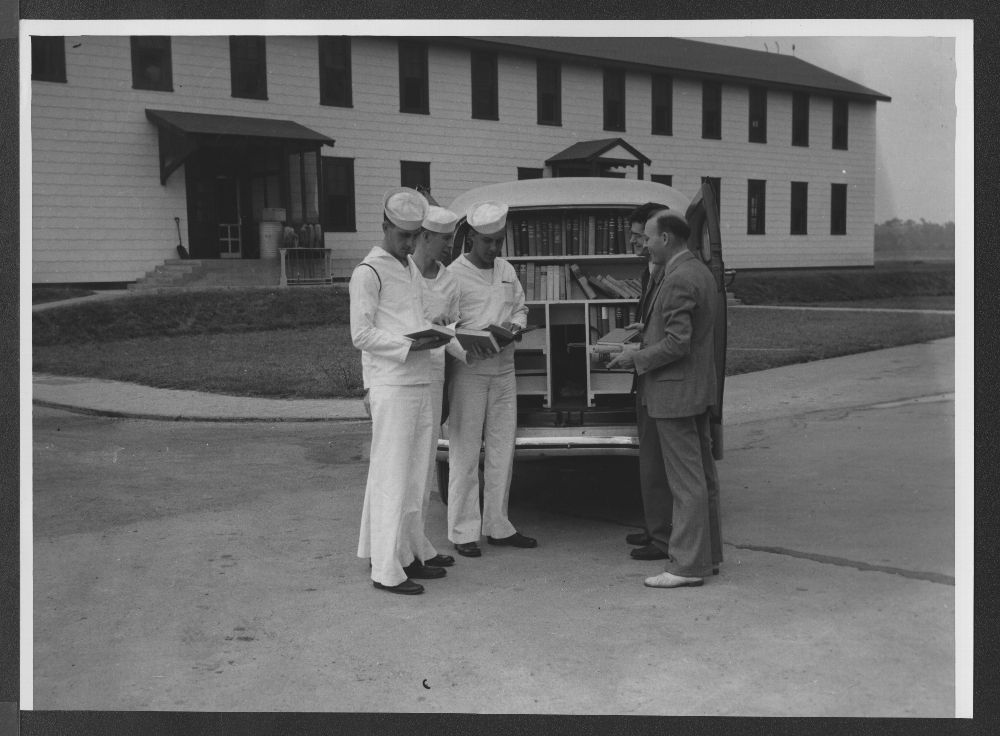 Bookmobile delivering books to sailors