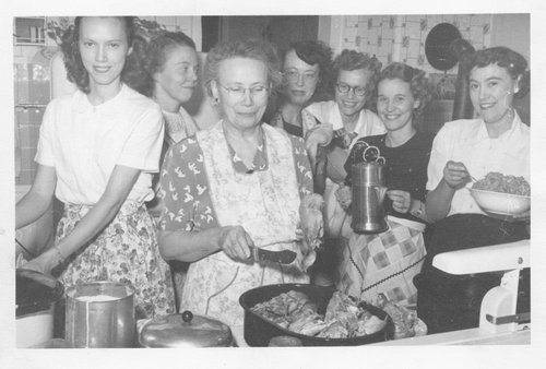 Dedonder family cooking holiday meal, circa 1940