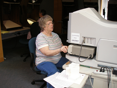 Volunteer using a microfilm printer