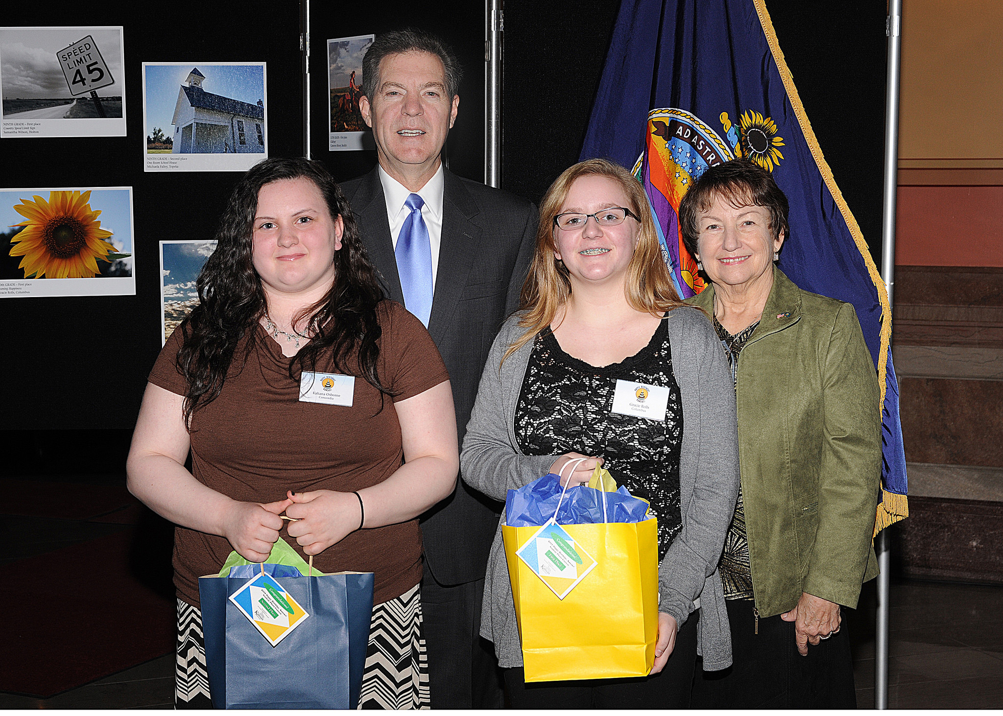 10th grade winners Kaliana Osborne and Gracie Rolls with Governor Sam Brownback and Marearl Denning