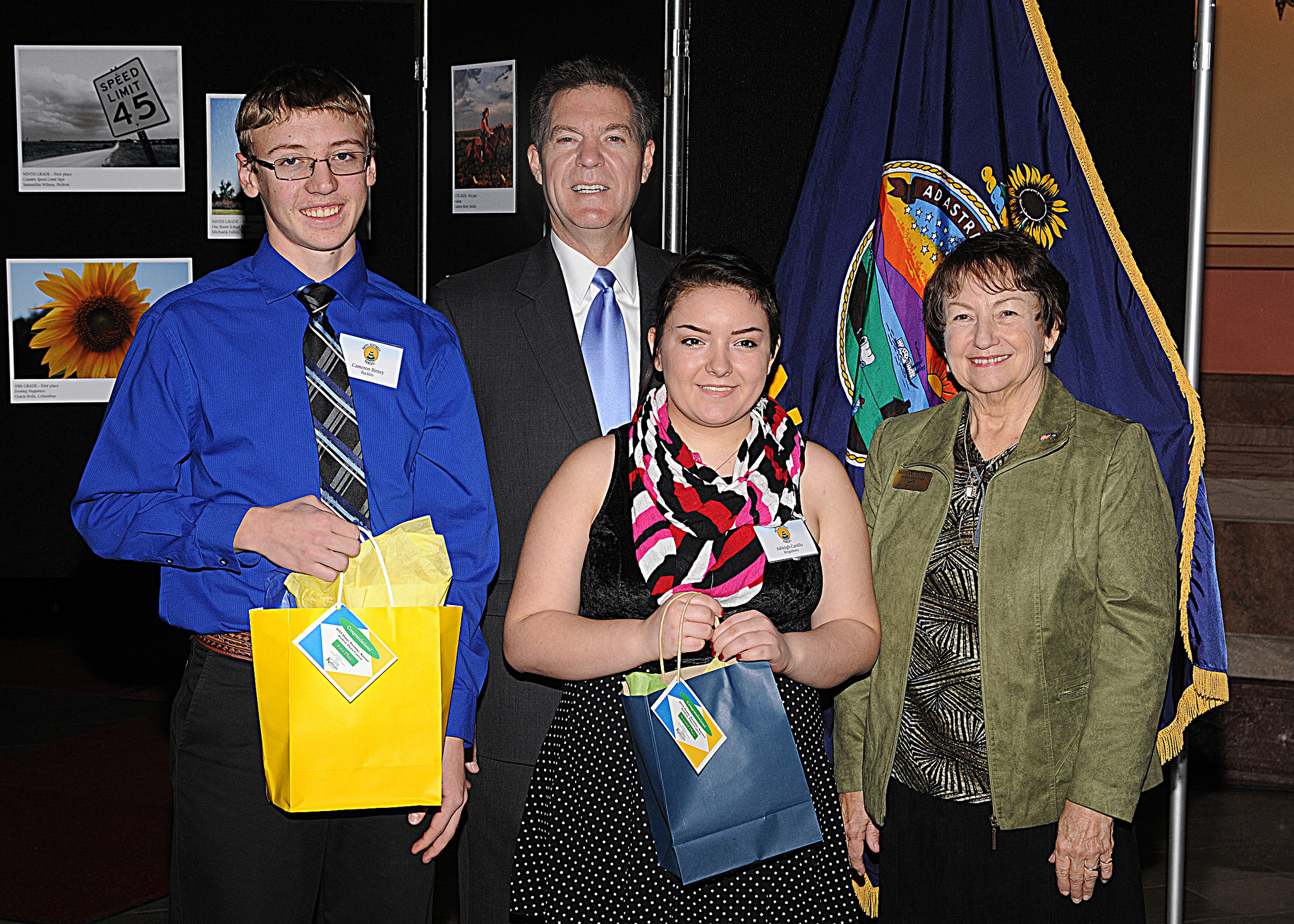 11th grade winners Cameron Birney and Ashleigh Carrillo with Governor Sam Brownback and Marearl Denning