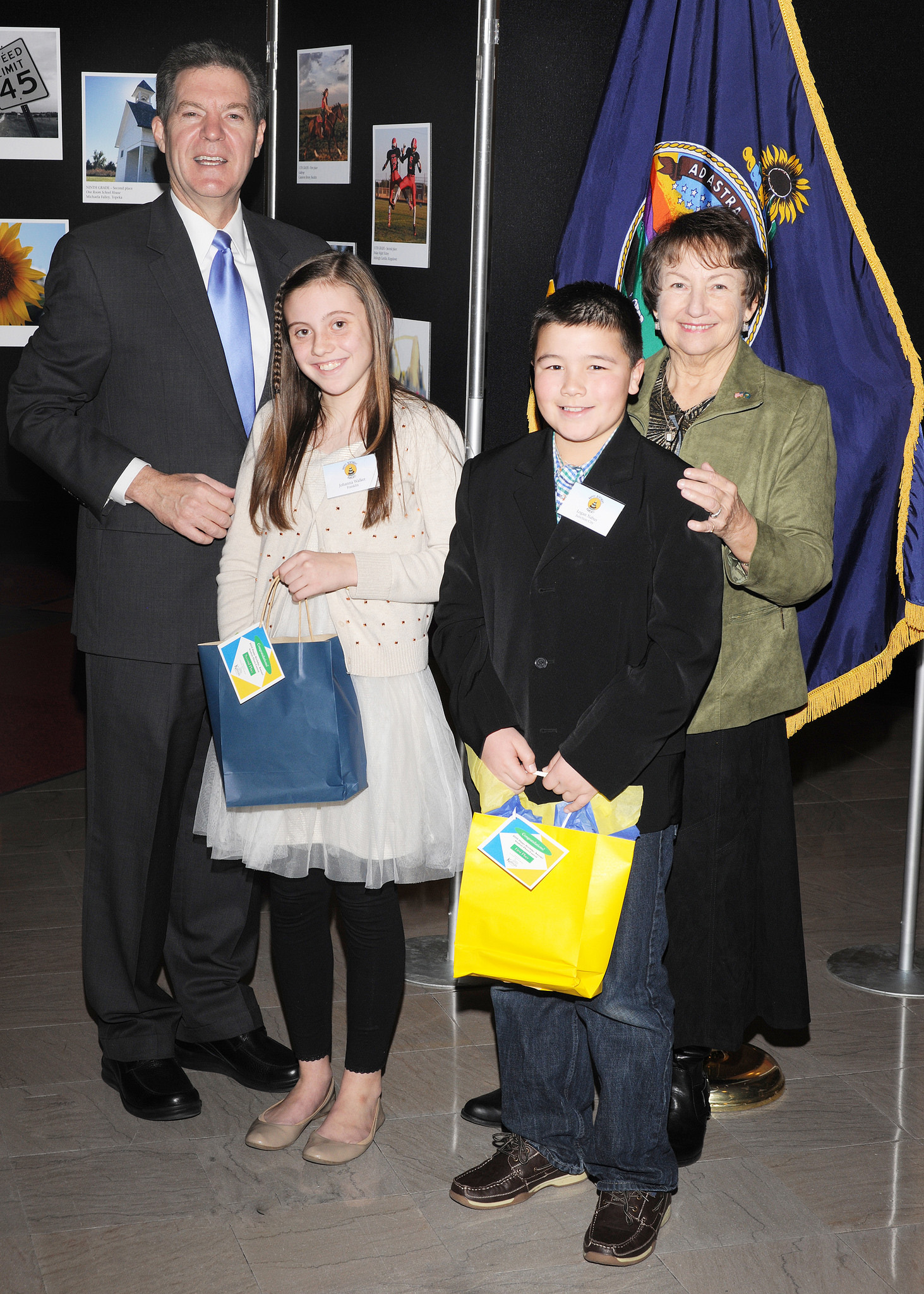 Fifth grade winners Johanna Walker and Logan Nabus with Governor Sam Brownback and Marearl Denning