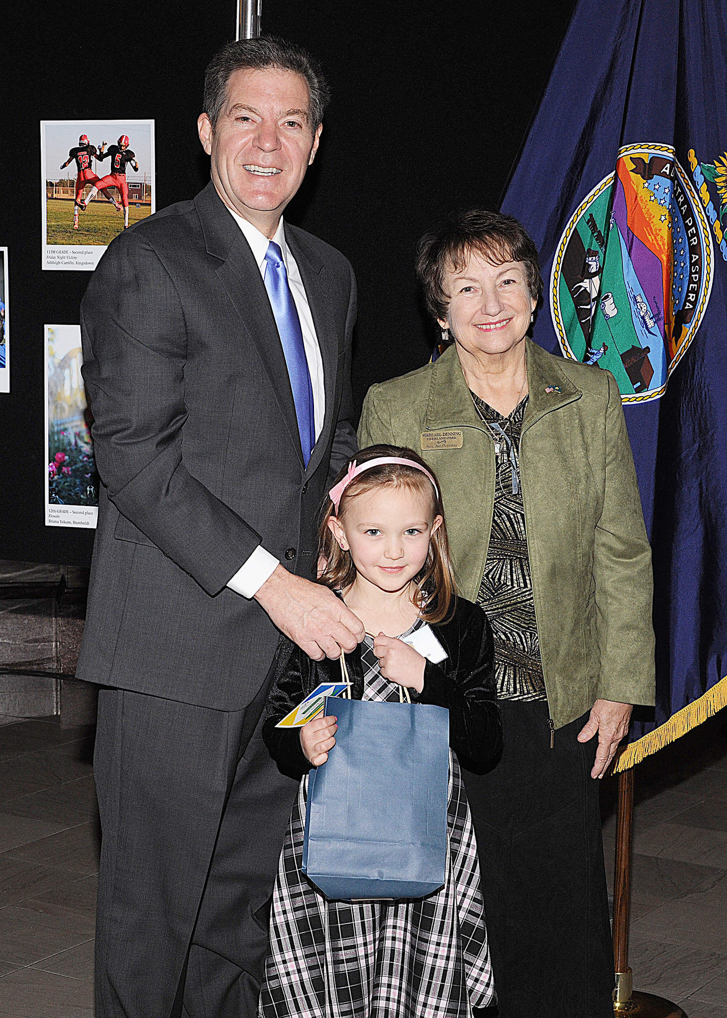 First grade winner Michaela Ferguson with Governor Sam Brownback and Marearl Denning
