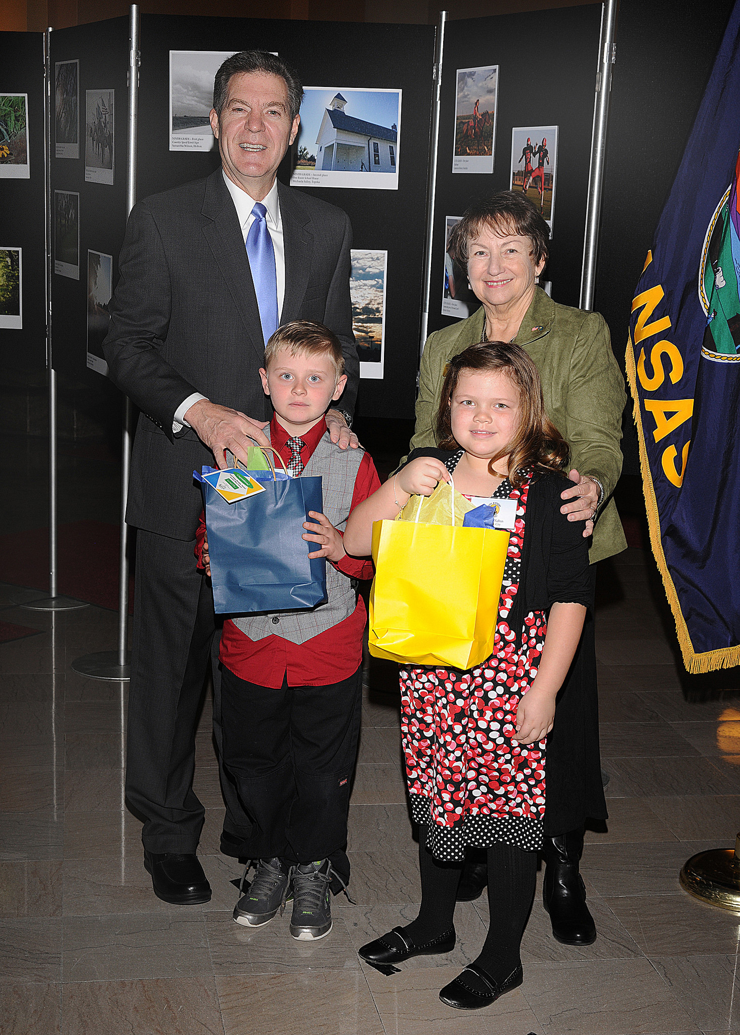 Second grade winners Spencer Wilson and Morgan Nabus with Governor Sam Brownback and Marearl Denning