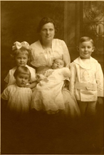 The Hughes family portrait taken in 1918 when James was in Europe. The children from left to right: Betty born 1914; Peggy born 1916; Bill born 1918; and James Renwick born 1911.