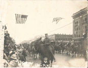 In Topeka, like cities across the country, patriotic parades were used for military recruitment.  Captain James C. Hughes, on the horse in front, parades with Field Artillery Battery A of the Kansas National Guard down Kansas Avenue.