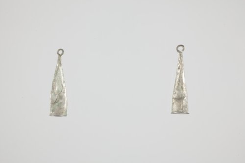 Silver earrings from Fool Chief's Village, 1828-1844