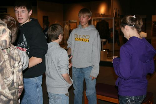 Students learn by discussing the items in the exhibit.