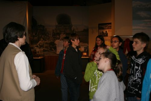 Participating in a guided tour of the museum.
