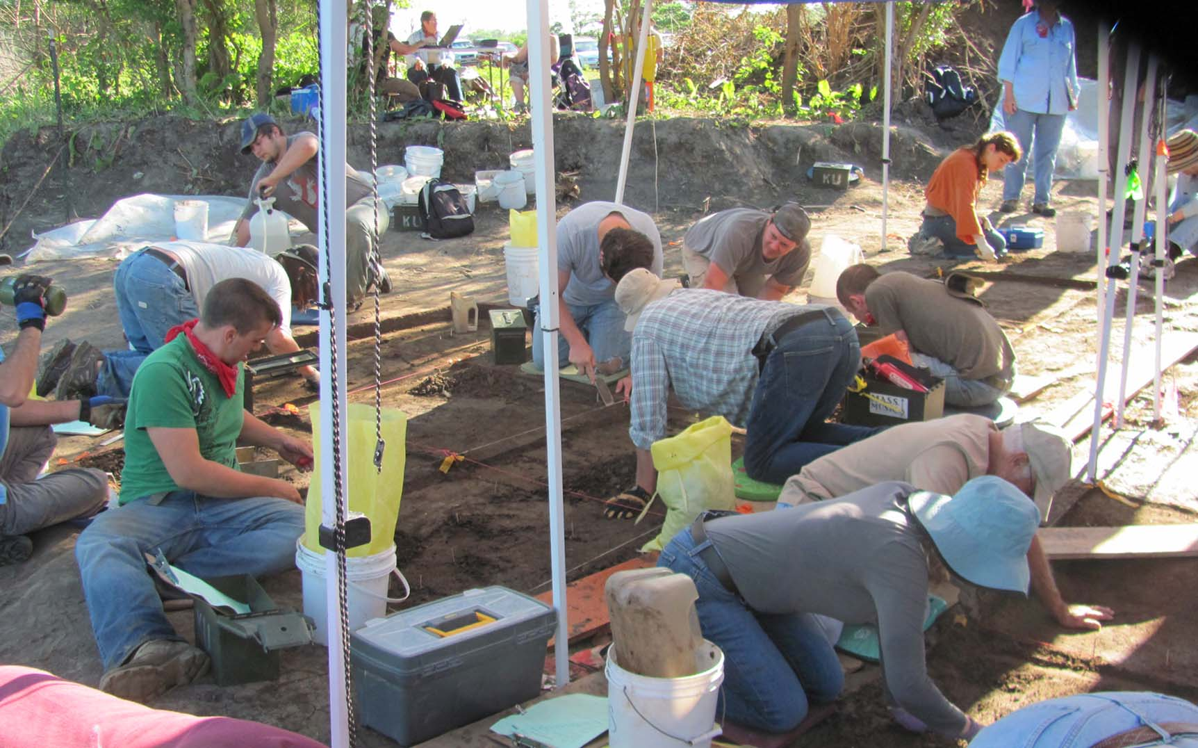 People working at archeology excavation site