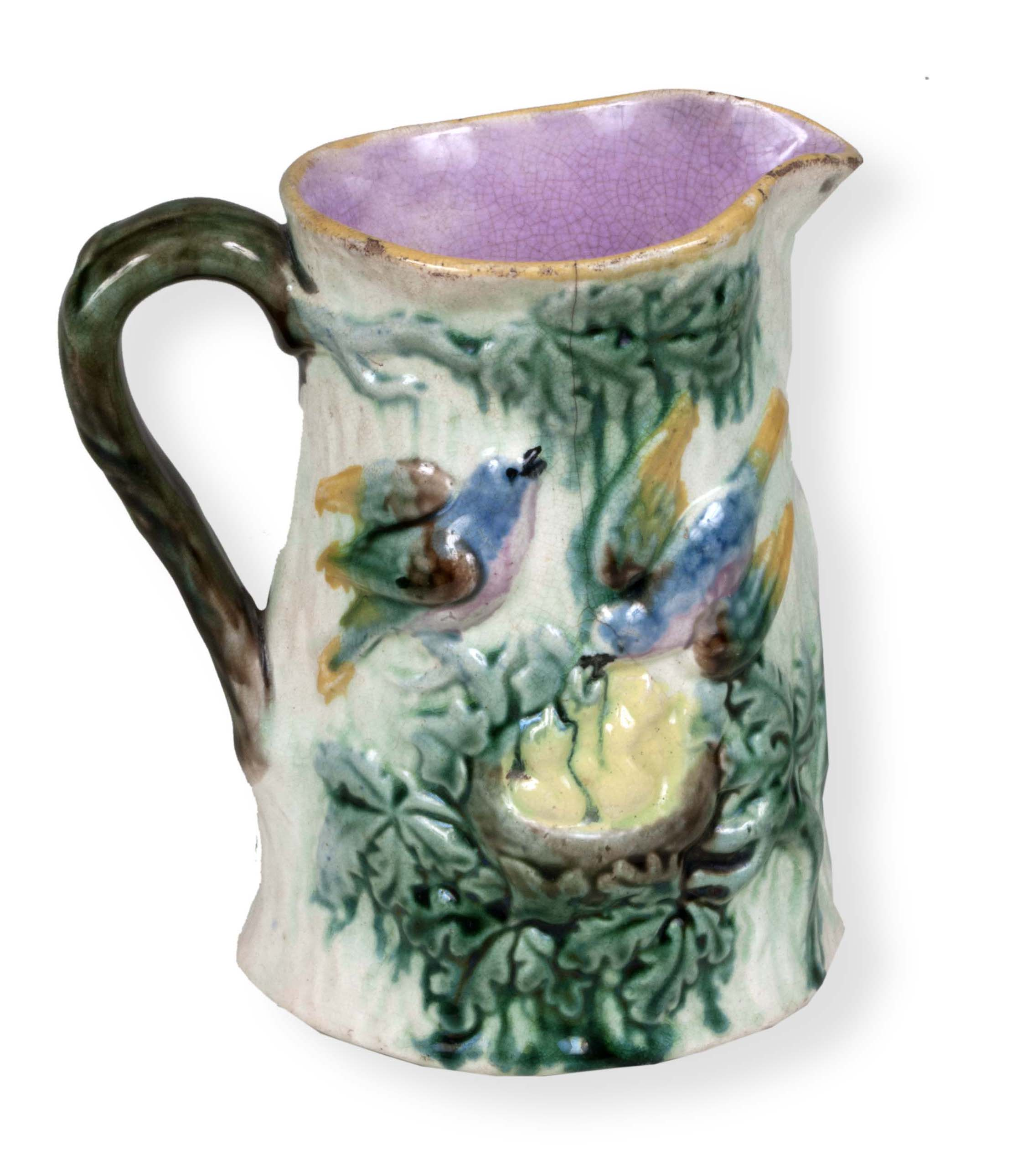 Glass pitcher with blue and pink birds