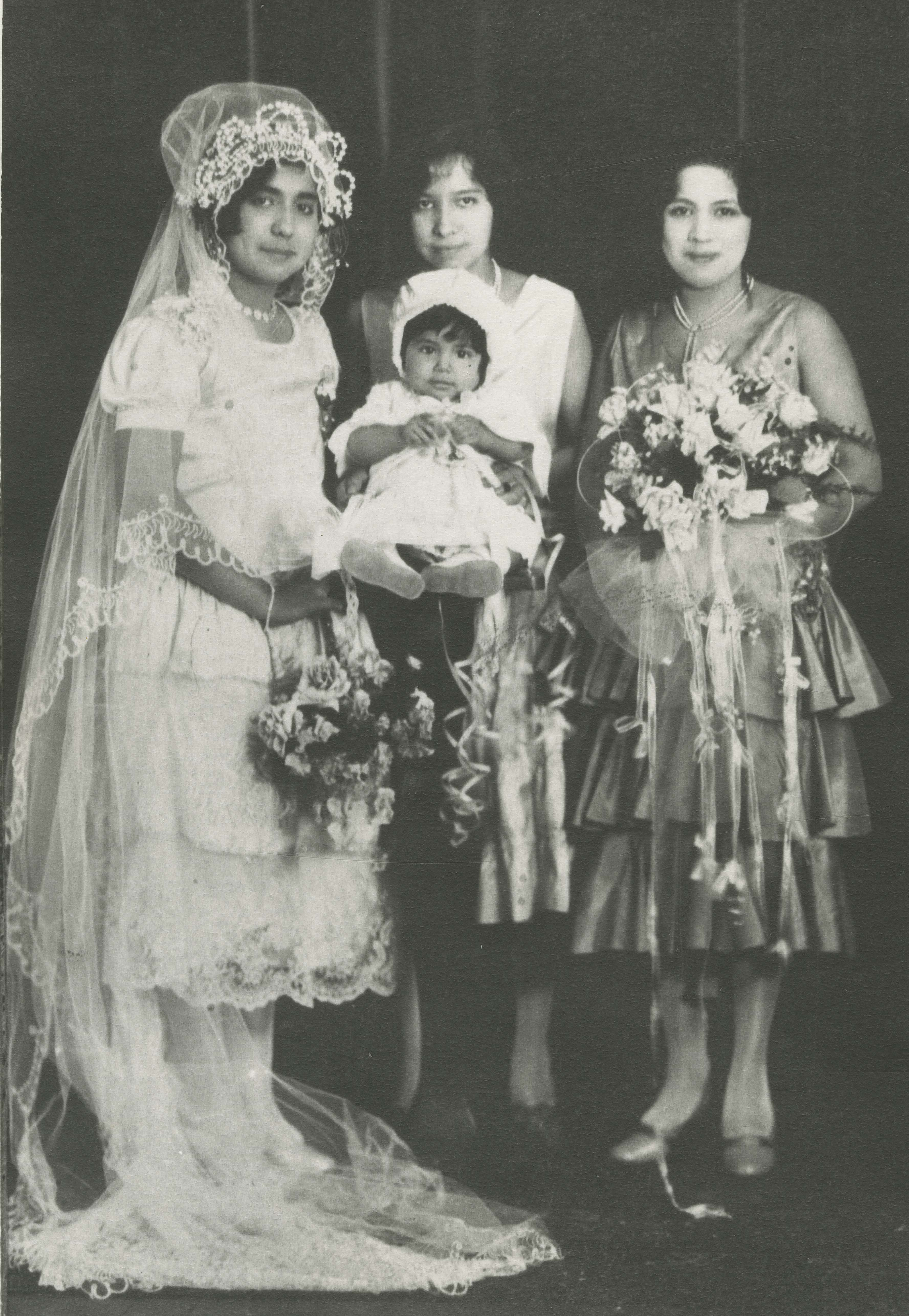 Bride and attendants in their wedding clothes.