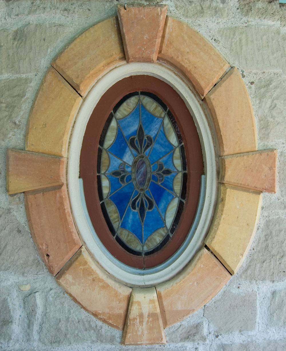 Exterior view of stained glass window in guest bedroom, Cottonwood Ranch State Historic Site