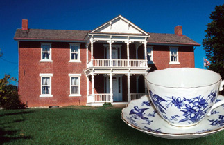 Grinter Place exterior with tea cup placed in front.