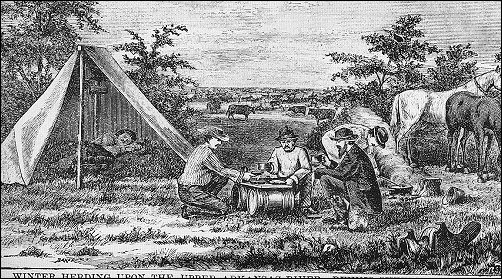 men squatting at a makeshift table of a board over two small barrels, and a man sleeping in a tent in the background