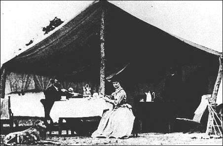 Custer and Elizabeth at ease in their tent home in Ellis County, Kansas, probably in 1869, after his reinstatement as field commander of the Seventh U.S. cavalry.