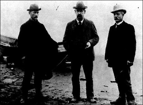 Wyatt Earp with Ed Englestadt and John Club on beach in Nome, Alaska