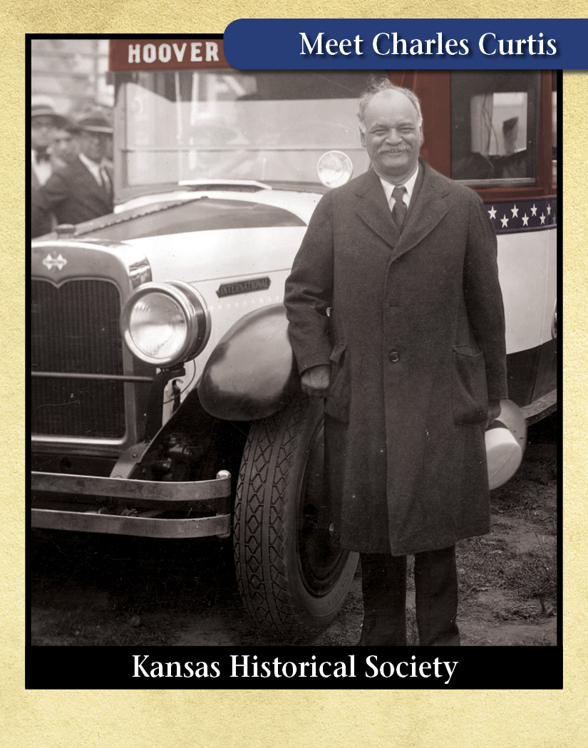 Charles Curtis standing in front of Hoover-Curtis campaign bus.
