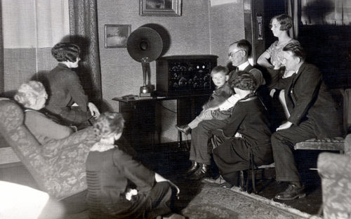 Allen D. Birch and family gathered to listen to radio at their home in Topeka, 1920s.