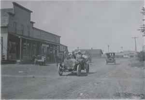 Cars passing through Dorrance, Kansas, as part of Glidden Tour