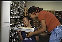 Image of two young researchers using the card catalogs.