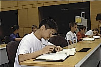Image of a student researching in the State Archives and Library reading room