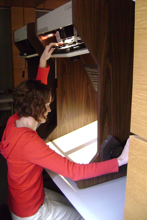 Researcher using a microfilm reader