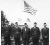 Veterans posed with a flag in Cimarron, circa 1945
